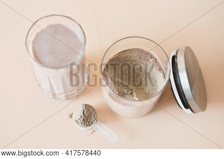 Whey Drink In A High Glass. Whey Protein Chocolate Cocktail. Morning Drink For Health And Beauty. To