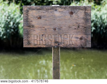 empty wooden sign without inscription.