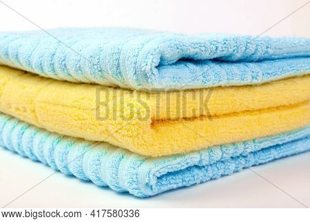 Side View Of A Stack Of Fluffy Terry Towels