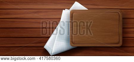 Wooden Cutting Board Stand On Kitchen Napkin And Wood Table Surface Top View. Rectangular Empty Tray
