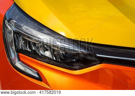 Orange Car Headlights. Exterior Detail. Close Up Detail On One Of The Led Headlights Modern Car.
