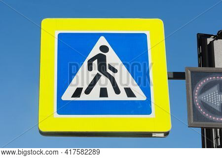 Pedestrian Crossing Sign On The Street. Transition Symbol. A Person Walks Along The Transition In A