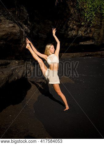 Yoga Practice. Slim Caucasian Woman Practicing Samsahate Hanumanasana, Standing Split Pose. Hamstrin