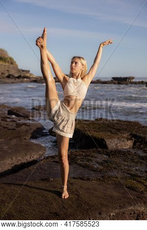 Yoga Practice. Caucasian Woman Practicing Samsahate Hanumanasana, Standing Split Pose. Hamstrings St