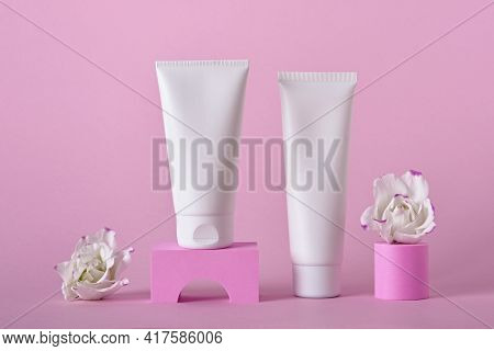 Beauty Natural Skincare Product Mock Up. Cream Tubes And Flowers On Different Geometric Podiums. Bod