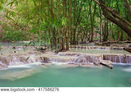 Waterfall In Deepwooden Swing In Wang Kan Luang Waterfall For Relaxation Natural Therapy, Lopburi Pr