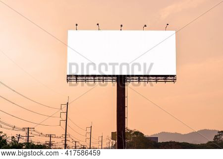 Billboard Blank For Advertising Poster Or Blank Billboard At Night Time For Advertisement On Road