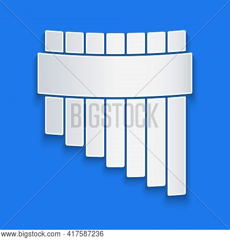 Paper Cut Pan Flute Icon Isolated On Blue Background. Traditional Peruvian Musical Instrument. Zampo