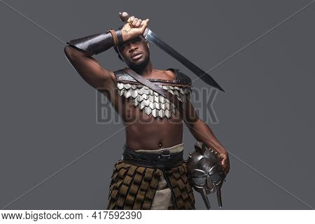 Weary African Gladiator With Sword And Helmet