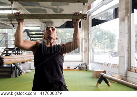 Young Man Strength Training Doing Pull Ups At The Gym, Active And Sporty Lifestyle Concept, Copyspac