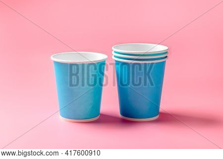 Disposable Paper Cup On A Pink Background. Disposable Tableware. Disposable Goods. Concept.
