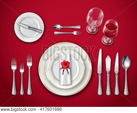 Top View Of Table Place Setting For Ceremonial Dinner On Red Background With Empty Plate Glasses And