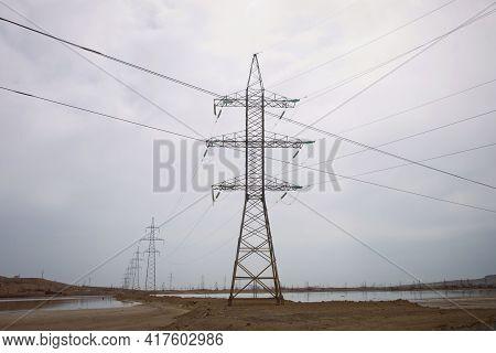 High Voltage Post. High-voltage Tower Sky Background . Transmission Line Tower On Blue Sky . High Vo