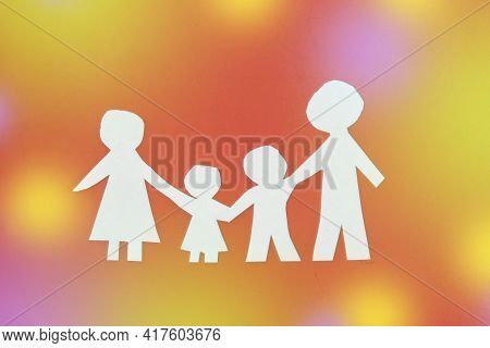 Family Made Of Paper, A Symbol Of A Happy Strong Family, Against The Glare. Children's Day, Family D