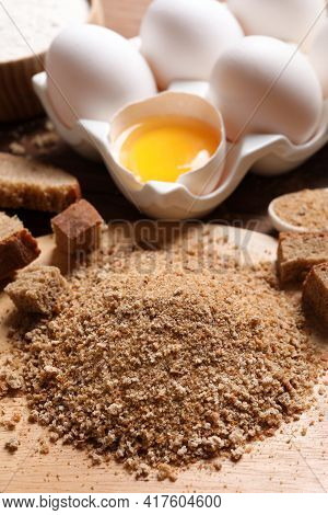 Fresh Breadcrumbs And Eggs On Wooden Table
