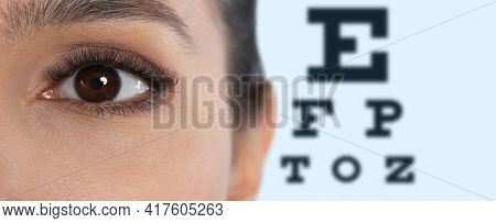 Closeup View Of Woman And Blurred Eye Chart On Background, Banner Design. Visiting Ophthalmologist