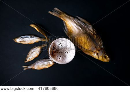 Dried Salted Roach, Delicious Clip Fish On A Wooden Background. A Popular Beer Snack. Traditional Me