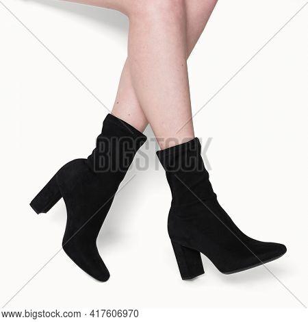 Black velvet sock boots close up shot with design space