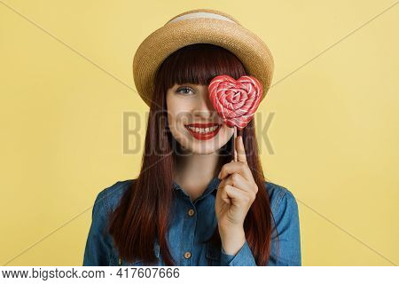 Sweet Life And Confectionarysmiling Curly African Girl In Bright Yellow Dress Holding Candy Lollipop