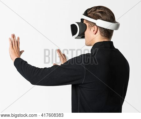 Man in VR headset touching invisible screen