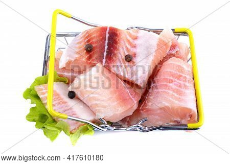 Pangasius Fish Fillet, Sliced Into Pieces In The Shopping Basket. Isolated On A White Background. Fr