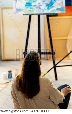 Artistic Woman. Enjoying Masterpiece. Creating Artwork. Inspiration Muse. Thoughtful Lady Sitting Fl