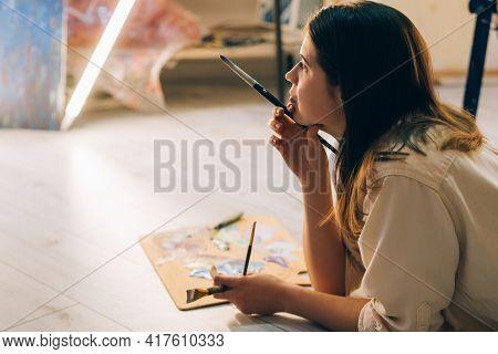 Female Artist. Lost Inspiration. Art School. Creative Process. Study Education. Pretty Woman Laying