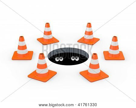 Traffic Cones Around A Manhole