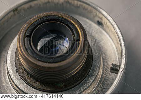 Old, Vintage Film Camera Lens Close Up Macro Shot. The Iris Diaphragm Of Old Camera Lens