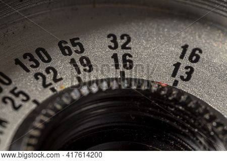 Old, Vintage Film Camera Lens Close Up Macro Shot. Closeup Lens With Aperture Scale