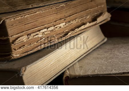 Stacks Of Old Multi-format Books With Scuffs. Low Depth Of Field Photography