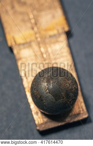 Closeup Of A Rusty Ball Bearing On A Copper Plate. Low Depth Of Field Photography
