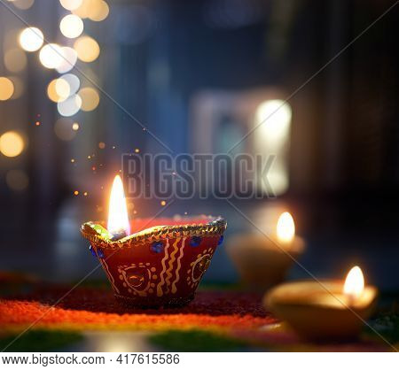 Happy Diwali, Lit Diya Lamp On Street At Night With Shallow Depth Of Field Background