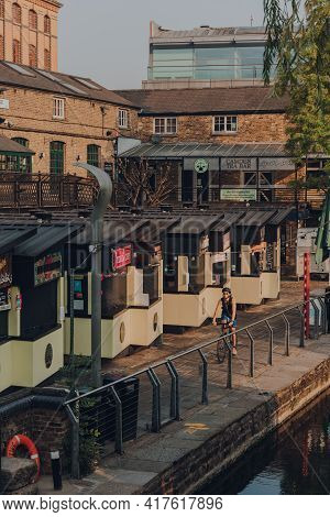 London, Uk - August 12,2020: High Angle View Of Closed Food Stalls In Camden Market, Man Cycles Past
