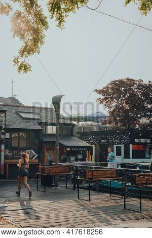 London, Uk - August 12,2020: Closed Food Stalls In Camden Market, People Running Past. Started With