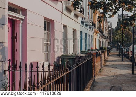 London, Uk - August 12, 2020: Row Of Pastel Coloured Terraced Houses In Camden, London, An Area Fame