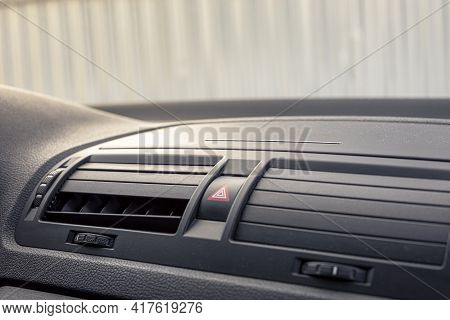 Broken Air Conditioner Vent Grill In A Modern Car. Sunny Clear Day.