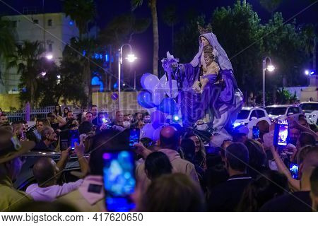 Haifa, Israel - April 18, 2021: The Statue Of Mary Is Greeted By The Local Christian Community Membe
