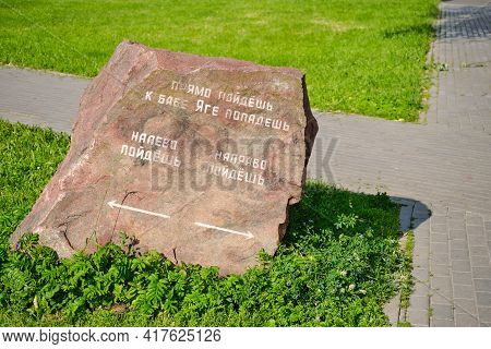 A Stone From Russian Fairy Tales Near The Road With The Inscription: Go Right, Go Left And Go Straig