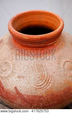 A Close Up Shot Of A Clay Pot.pottery Is The Process Of Forming Vessels And Other Objects With Clay
