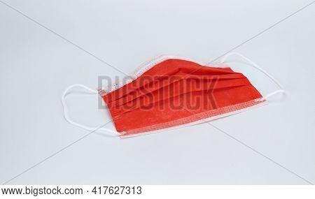 Medical Sterile Disposable Mask, White Background. Red Surgical Mask, Cover The Mouth And Nose. Resp