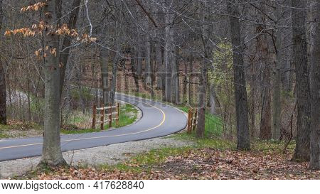 Scenic biking trail through woods