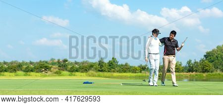 Group Golf Playing. Professional Golfer Asian Man Walking And Hug For Friendship After Finish Put Go