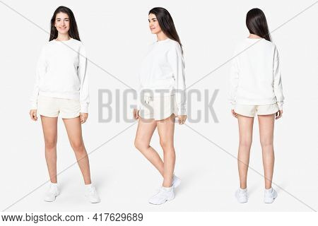 Woman in white sweater and shorts casual wear