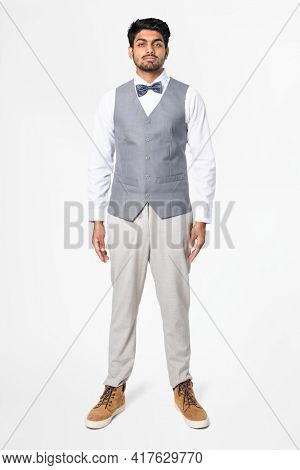 Man in gray vest suit and bow tie men's formal attire full body
