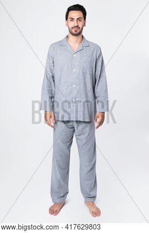 Man in gray pajamas comfy sleepwear apparel full body