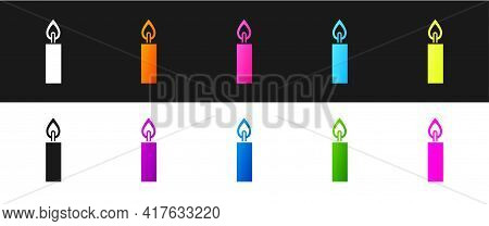 Set Burning Candle Icon Isolated On Black And White Background. Cylindrical Candle Stick With Burnin