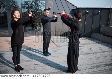 Kung Fu Instructor Finishing The Lesson With Formal Greeting Gesture