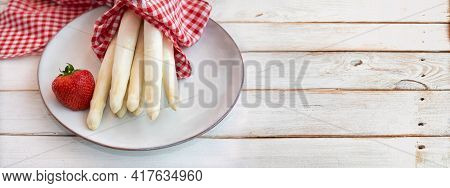 Uncooked White Asparagus With Strawbeery And Red Checkered Cloth On Vintage Wooden Planks. Fresh Ing