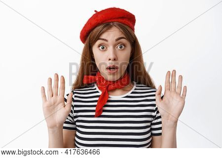 Cute French Girl Raising Hands Up As If Leaning On Invisible Glass, Pantomime Actor Performing, Stan